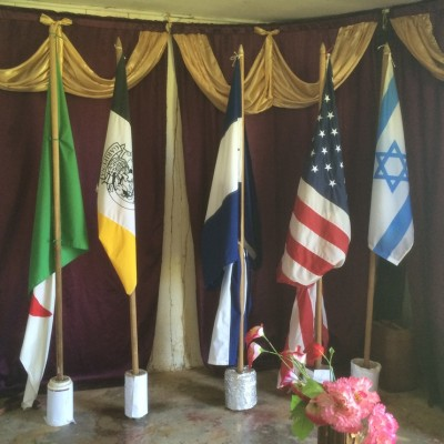 The meaning of the flags:  The first is Israel, the birthplace of Jesus; the second is USA, where the first missionaries to the Garifuna came from; the next is Honduras, representing where the missionaries went first in their country; the fourth is the Garifuna flag, where the missionaries eventually came; and the fifth is Algeria, representing the Muslim world where the Garifuna want to eventually send missionaries.